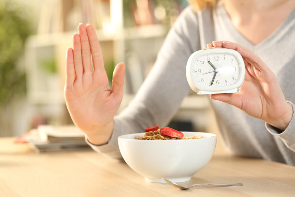 Woman hands on intermittent fasting doing stop sign