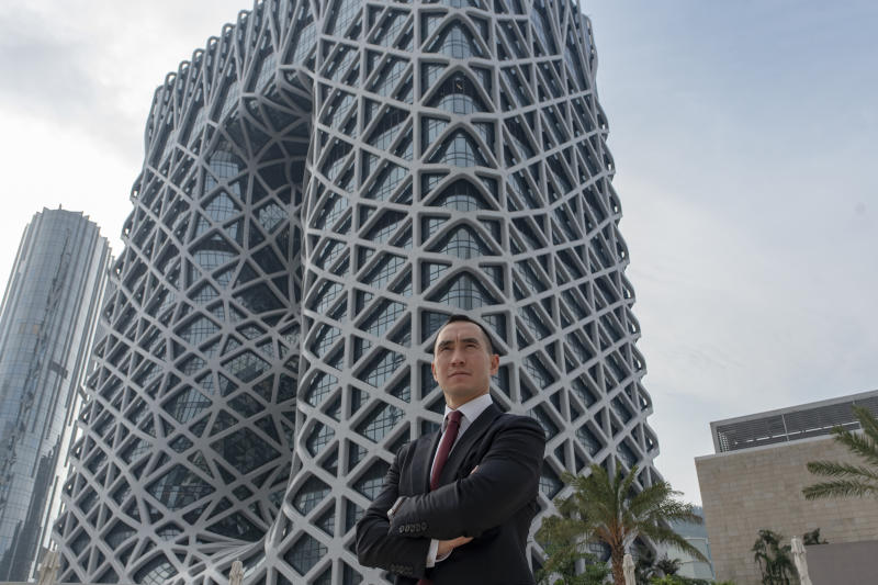 """Melco Resorts and Entertainment chairman Lawrence Ho poses for a picture in front of Melco's new hotel """"Morpheus"""" after an interview with AFP in Macau on June 15, 2018. - The flamboyant new casino designed by Zaha Hadid opened its doors in Macau on June 15, featuring futuristic curves and skeletal steel structures typical of the acclaimed late architect. (Photo by Philip FONG / AFP) (Photo credit should read PHILIP FONG/AFP via Getty Images)"""