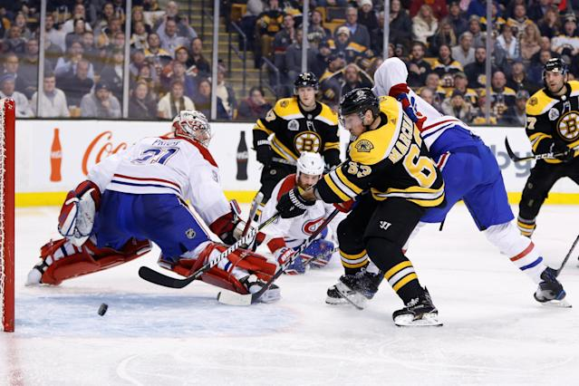 Jan 17, 2018; Boston, MA, USA; Boston Bruins left wind Brad Marchand (63) scores a goal on Montreal Canadiens goalie Carey Price (31) during the third period at TD Garden. Mandatory Credit: Greg M. Cooper-USA TODAY Sports TPX IMAGES OF THE DAY