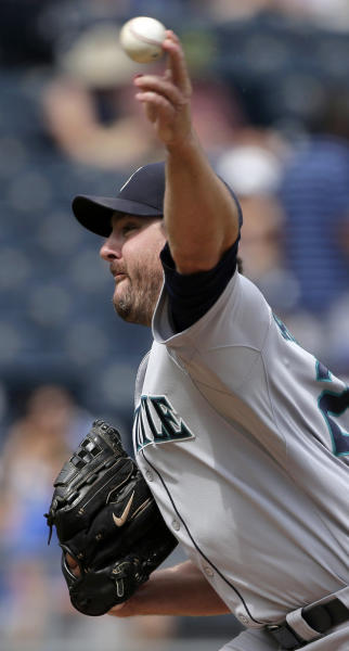 Seattle Mariners starting pitcher Joe Saunders throws during the first inning of a baseball game against the Kansas City Royals Thursday, Sept. 5, 2013, in Kansas City, Mo. (AP Photo/Charlie Riedel)