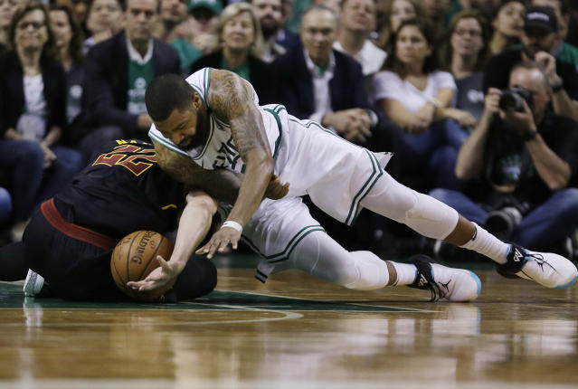 Boston Celtics forward Marcus Morris (13) dives for a loose ball next to Cleveland Cavaliers forward Larry Nance Jr., left, during the fourth quarter of Game 5 of the NBA basketball Eastern Conference finals Wednesday, May 23, 2018, in Boston. (AP Photo/Charles Krupa)