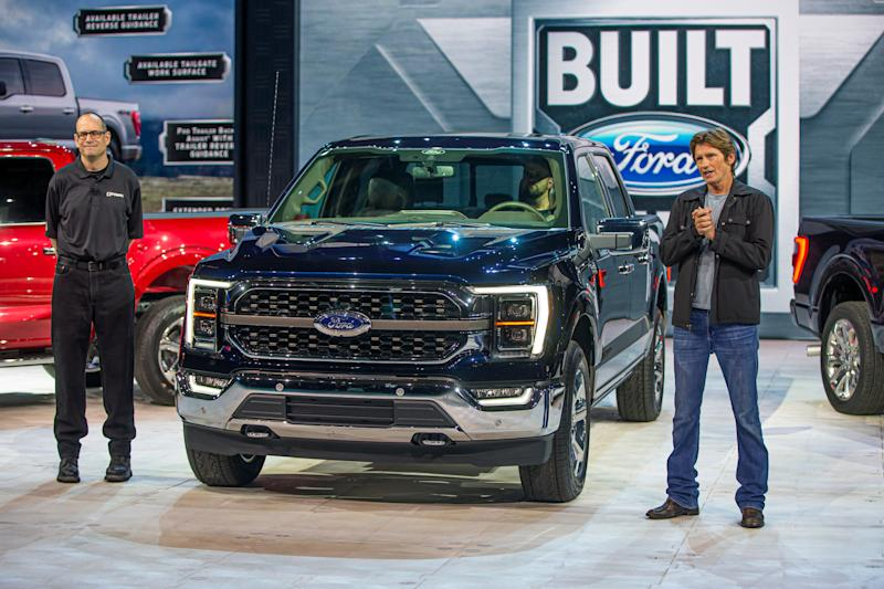(Left) Todd Eckert, Ford Motor Co. truck group marketing manager, and Dennis Leary, actor, philanthropist and F-150 reveal host, beside the all-new F-150 King Ranch in Antimatter Blue at the official reveal on June 25, 2020.