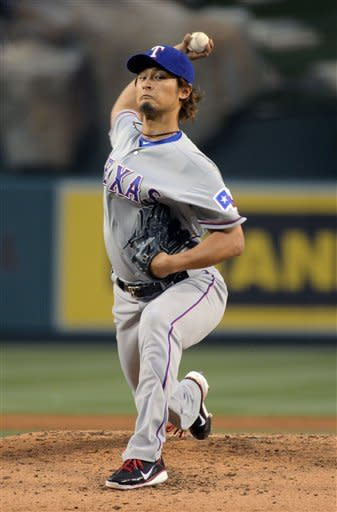 Texas Rangers starting pitcher Yu Darvish, of Japan, throws to the plate during the second inning of their baseball game against the Los Angeles Angels, Saturday, June 2, 2012, in Anaheim, Calif. (AP Photo/Mark J. Terrill)