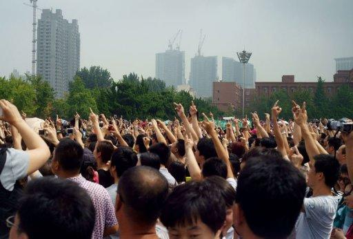 Chinese protesters rally against the building of the Fujia chemical plant in Dalian, in northeast China's Liaoning province, on August 14. An influential Chinese newspaper has urged citizens against taking their grievances to the streets, after thousands forced the closure of the plant which they said could belch out carcinogens