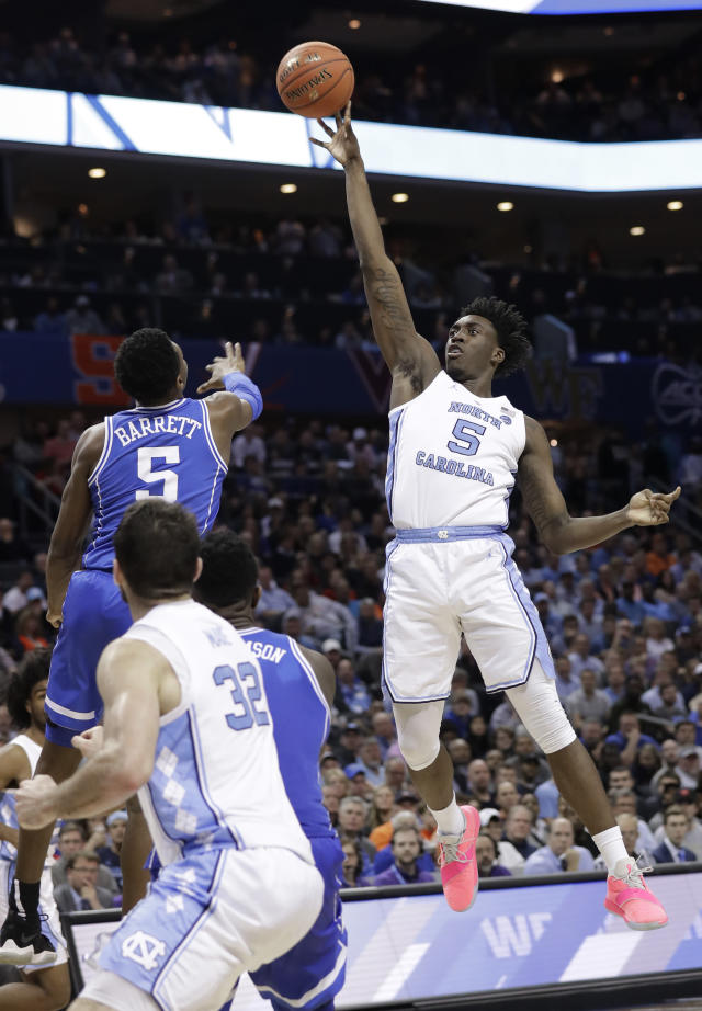 North Carolina's Nassir Little, right, shoots against Duke's R.J. Barrett, left, during the second half of an NCAA college basketball game in the Atlantic Coast Conference tournament in Charlotte, N.C., Friday, March 15, 2019. (AP Photo/Chuck Burton)