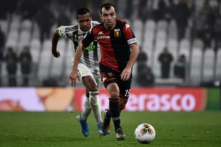 Goran Pandev, pictured here playing against Juventus, set Genoa on the way to a big win over SPAL (AFP Photo/MARCO BERTORELLO)
