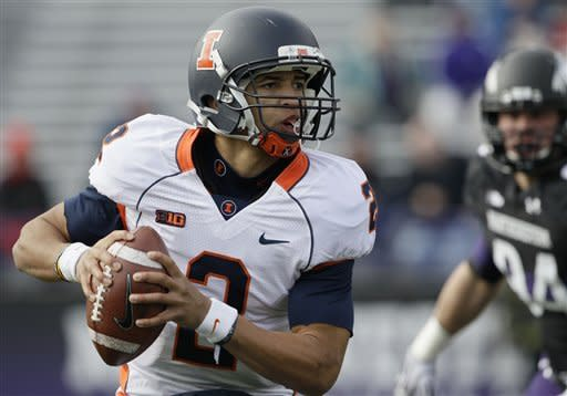 Illinois quarterback Nathan Scheelhaase (2) runs as he looks to a pass during the first half of an NCAA college football game against Northwestern in Evanston, Ill., Saturday, Nov. 24, 2012. (AP Photo/Nam Y. Huh)