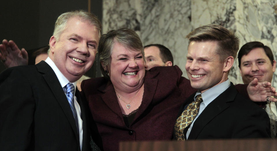 FILE - In this Feb. 13, 2012 file photo, Rep. Maureen Walsh, R-Walla Walla, center, playfully throws her arms around Sen. Ed Murray, D-Seattle, left, and Rep. Jamie Pedersen, D-Seattle, moments before Gov. Chris Gregoire signed into law a measure that legalizes same-sex marriage, in Olympia, Wash. Opponents of gay marriage have an unblemished track record in U.S. elections, chalking up 32 victories in 32 public votes. Encouraged by the prospects in Washington and Maine, gay marriage supporters are optimistic that they can end their losing ways this year, with four states voting on the issue in November. (AP Photo/Elaine Thompson, File)