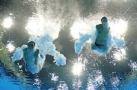 LONDON, ENGLAND - JULY 30: Yuan Cao and Yanquan Zhang of China compete in the Men's Synchronised 10m Platform Diving on Day 3 of the London 2012 Olympic Games at the Aquatics Centre on July 30, 2012 in London, England. (Photo by Adam Pretty/Getty Images)
