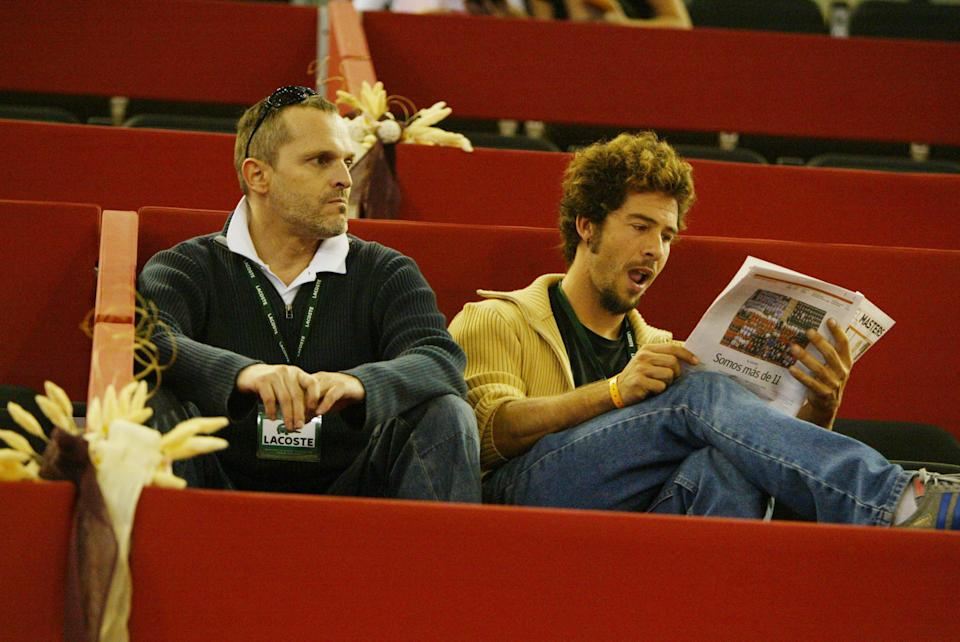Singer Miguel Bose (L) and scullptor Nacho Palau are seen during Mutua Madrid Open tennis tournament at the Caja Magica on October 26, 2004 in Madrid (Photo by Europa Press via Getty Images)