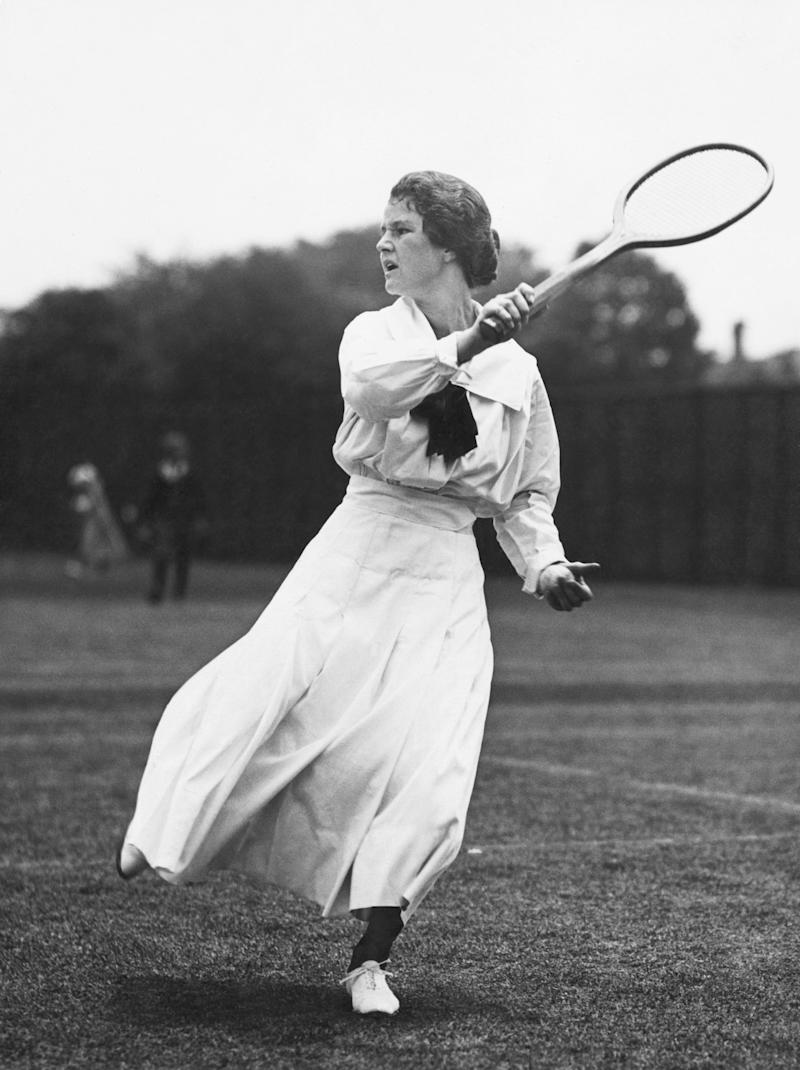 Woman swinging tennis racket circa 1900