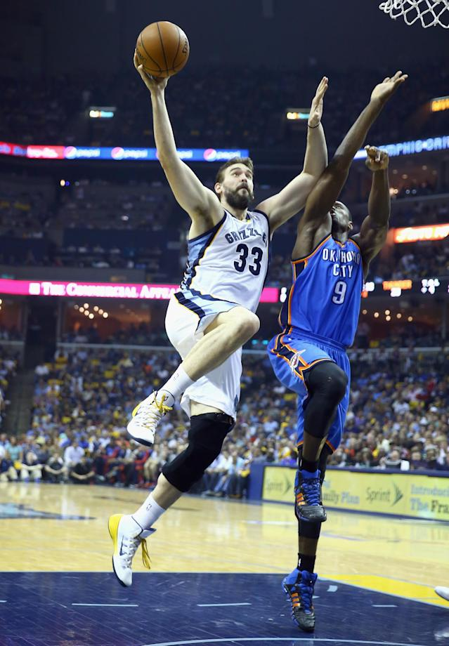 MEMPHIS, TN - APRIL 24: Marc Gasol #33 of the Memphis Grizzlies shoots the ball while defended by Serge Ibaka#9 of the Oklahoma City Thunder during Game 3 of the Western Conference Quarterfinals during the 2014 NBA Playoffs at FedExForum on April 24, 2014 in Memphis, Tennessee. NOTE TO USER: User expressly acknowledges and agrees that, by downloading and or using this photograph, User is consenting to the terms and conditions of the Getty Images License Agreement. (Photo by Andy Lyons/Getty Images)