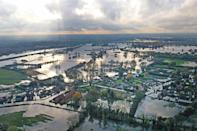 """In November, parts of the north of England were devastated by severe flooding. The village of Fishlake, near Doncaster, South Yorkshire, was one of the worst places affected, with many residents reluctant to leave their homes despite council warnings. Experts called the flooding a """"once-in-60-years"""" weather event (Picture: PA)"""
