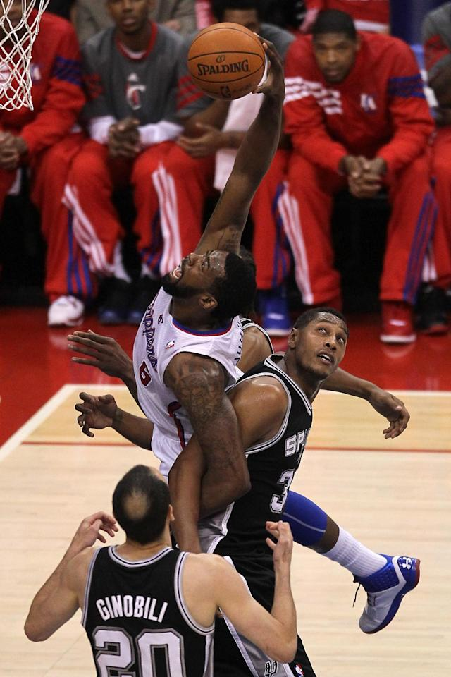 LOS ANGELES, CA - MAY 20: DeAndre Jordan #6 of the Los Angeles Clippers is tangled up with Boris Diaw #33 of the San Antonio Spurs on a shot in the lane in Game Four of the Western Conference Semifinals in the 2012 NBA Playoffs on May 20, 2011 at Staples Center in Los Angeles, California. NOTE TO USER: User expressly acknowledges and agrees that, by downloading and or using this photograph, User is consenting to the terms and conditions of the Getty Images License Agreement. (Photo by Jeff Gross/Getty Images)