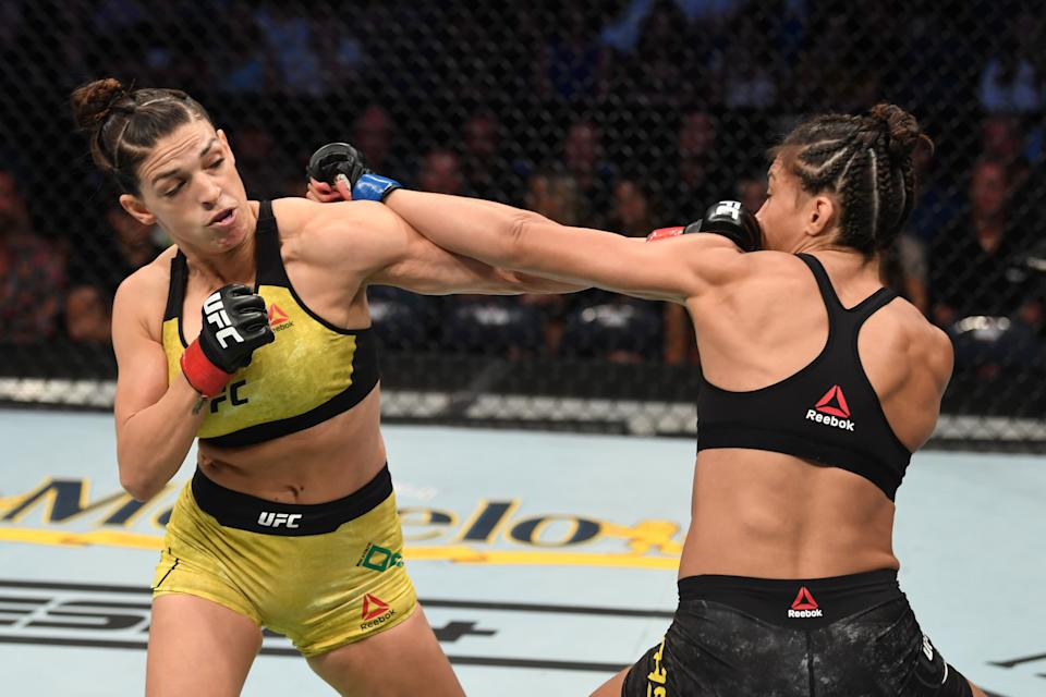 TAMPA, FLORIDA - OCTOBER 12: (L-R) Mackenzie Dern punches Amanda Ribas of Brazil in their women's strawweight bout during the UFC Fight Night event at Amalie Arena on October 12, 2019 in Tampa, Florida. (Photo by Josh Hedges/Zuffa LLC via Getty Images)