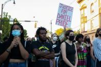 Demonstrators take part in a protest in Rochester, New York