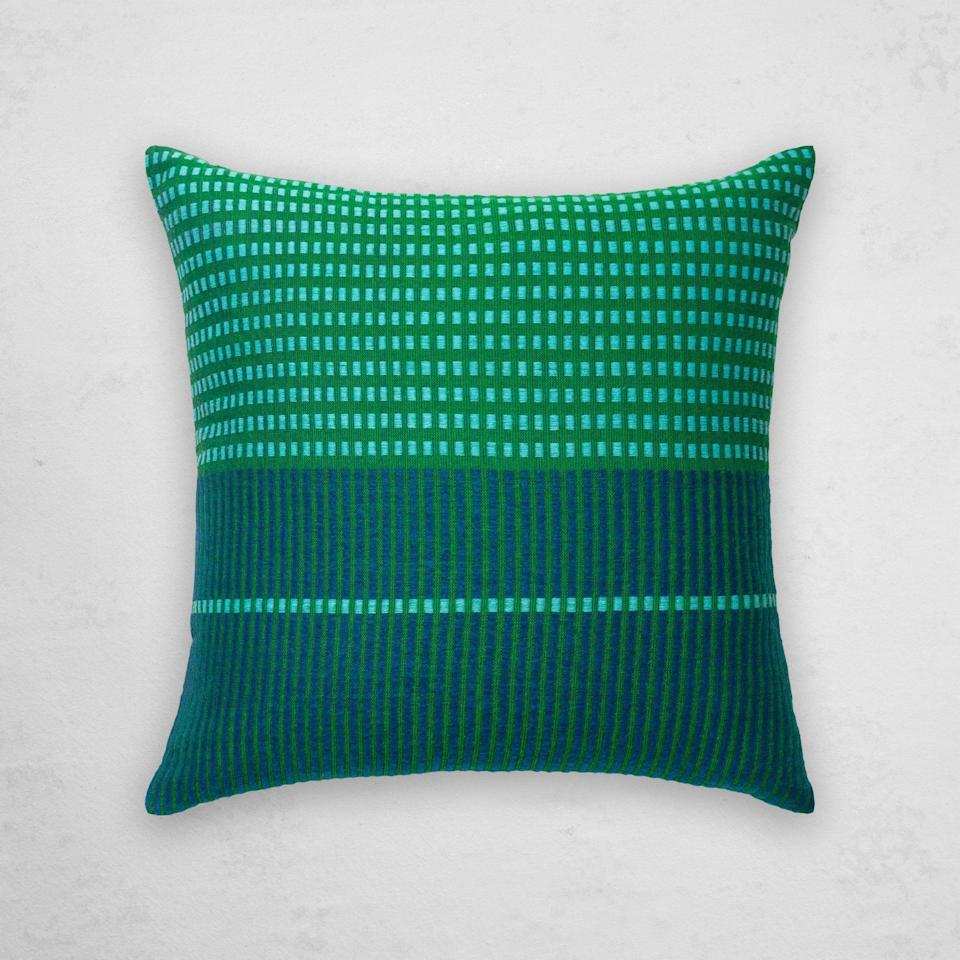 """<p><strong>Bole Road Textiles</strong></p><p>boleroadtextiles.com</p><p><strong>$140.00</strong></p><p><a href=""""https://boleroadtextiles.com/collections/pillows/products/asum-pillow-cobalt"""" rel=""""nofollow noopener"""" target=""""_blank"""" data-ylk=""""slk:Shop Now"""" class=""""link rapid-noclick-resp"""">Shop Now</a></p><p>If you want a more unique pillow, this one from Bole Road Textiles has the prettiest color combination and is handwoven in Ethiopia. </p>"""