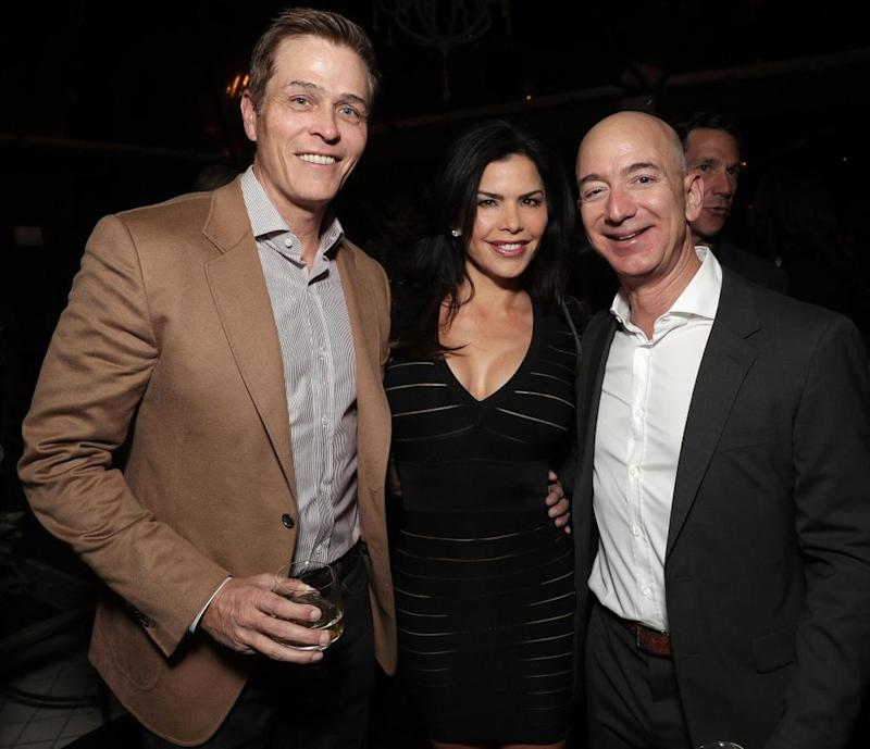 (from left to right) Patrick Whitesell, Lauren Sanchez and Jeff Bezos at the 2016 Amazon holiday party for <em>Manchester by the Sea</em>