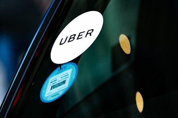 An Uber Technologies Inc. sticker is displayed on a vehicle in the Time Square neighborhood of New York, U.S., on Wednesday, May 8, 2019. Simmering tensions between drivers and ride-hailing companies are flaring again, as drivers in major cities across the U.S. and the U.K. went on strike Wednesday over low wages and unstable working conditions. Photographer: Jeenah Moon/Bloomberg via Getty Image