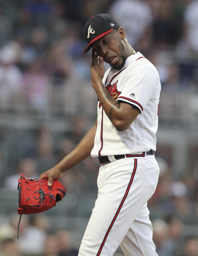Atlanta Braves Julio Teheran reacts as he leaves the game after being pulled in the second inning during a baseball game against the New York Mets Thursday, Aug.15, 2019, in Atlanta. (AP Photo/Tami Chappell)