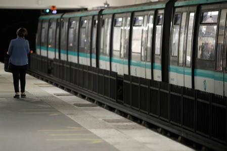 A passenger walks on a platform at the Gare du Nord subway station during a strike by all unions of the Paris transport network (RATP) against pension reform plans in Paris