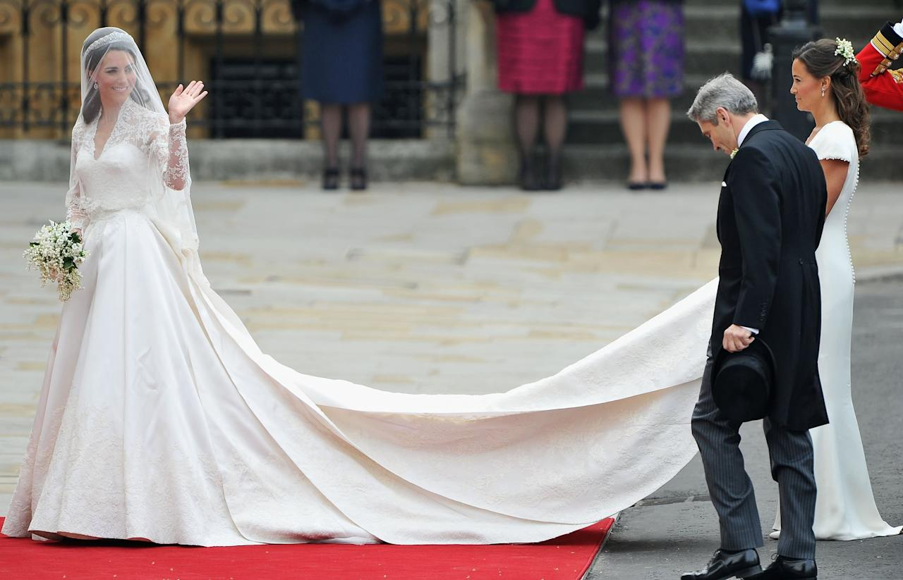 """<p>Sarah Burton created <a href=""""https://www.popsugar.com/fashion/Kate-Middleton-Wedding-Dress-16117636"""" class=""""ga-track"""" data-ga-category=""""Related"""" data-ga-label=""""https://www.popsugar.com/fashion/Kate-Middleton-Wedding-Dress-16117636"""" data-ga-action=""""In-Line Links"""">Kate's modest wedding dress</a>, which came with a long train that swept the aisle at Westminster Abbey on April 29.</p>"""