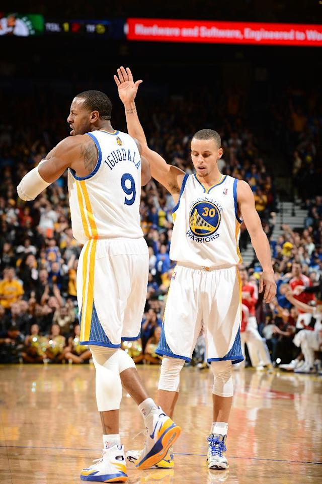 OAKLAND, CA - JANUARY 10: Stephen Curry #30 of the Golden State Warriors celebrates with teammate Andre Iguodala #9 during the game against the Boston Celtics on January 10, 2014 at Oracle Arena in Oakland, California. (Photo by Garrett Ellwood/NBAE via Getty Images)