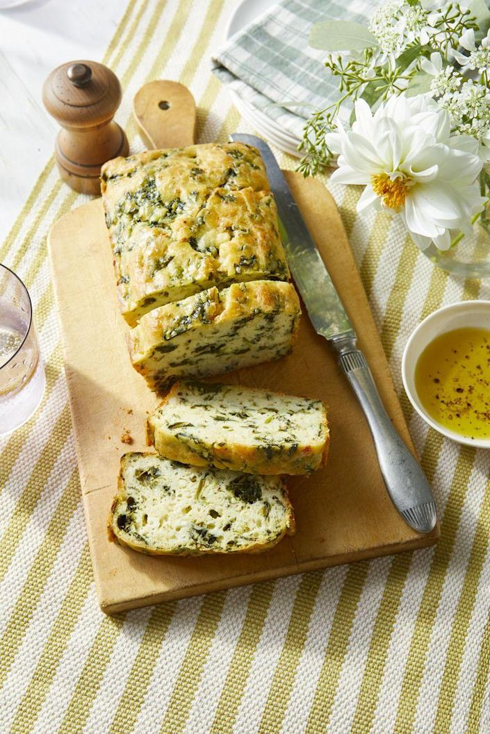 """<p>This healthier take on a quick loaf is a great way to use frozen spinach and tastes just like the classic diner omelet. </p><p><strong><a href=""""https://www.countryliving.com/food-drinks/a34946991/spinach-and-feta-quick-bread-recipe/"""" rel=""""nofollow noopener"""" target=""""_blank"""" data-ylk=""""slk:Get the recipe"""" class=""""link rapid-noclick-resp"""">Get the recipe</a>.</strong></p><p><a class=""""link rapid-noclick-resp"""" href=""""https://www.amazon.com/USA-Pan-1140LF-Bakeware-Aluminized/dp/B0029JQEIC/?tag=syn-yahoo-20&ascsubtag=%5Bartid%7C10050.g.35246097%5Bsrc%7Cyahoo-us"""" rel=""""nofollow noopener"""" target=""""_blank"""" data-ylk=""""slk:SHOP LOAF PANS"""">SHOP LOAF PANS</a><br></p>"""