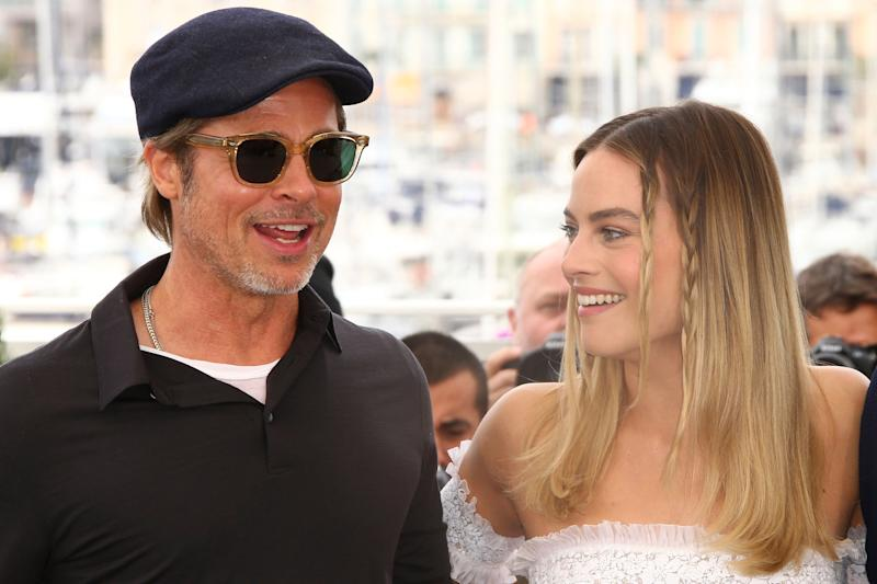 Actosr Brad Pitt, left and Margot Robbie pose for photographers at the photo call for the film 'Once Upon a Time in Hollywood' at the 72nd international film festival, Cannes, southern France, Wednesday, May 22, 2019. (Photo by Joel C Ryan/Invision/AP)