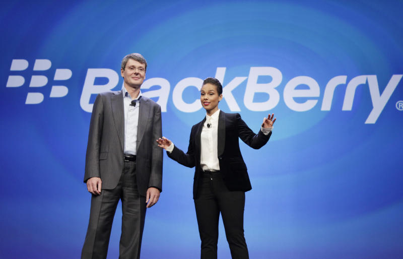 Thorsten Heins, CEO of Research in Motion, introduces Alicia Keys as the Global Creative director of BlackBerry, Wednesday, Jan. 30, 2013 in New York. The maker of the BlackBerry smartphone is promising a speedy browser, a superb typing experience and the ability to keep work and personal identities separate on the same phone, the fruit of a crucial, long-overdue makeover for the Canadian company. (AP Photo/Mark Lennihan)