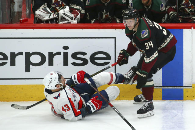 Arizona Coyotes center Carl Soderberg (34) sends Washington Capitals right wing Tom Wilson (43) to the ice during the first period of an NHL hockey game Saturday, Feb. 15, 2020, in Glendale, Ariz. (AP Photo/Ross D. Franklin)
