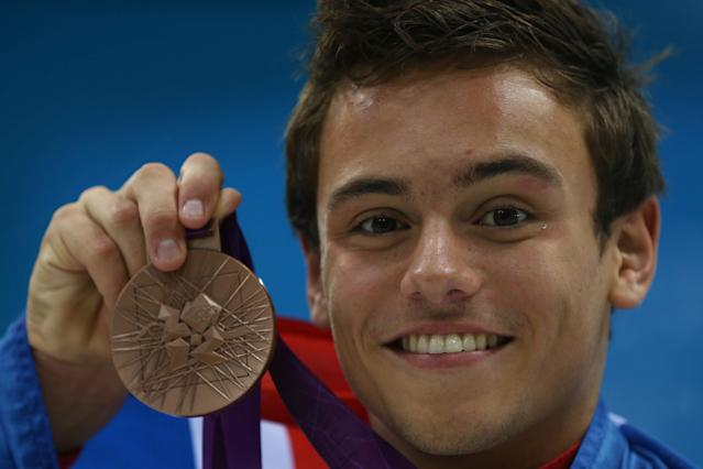LONDON, ENGLAND - AUGUST 11: Bronze medallist Tom Daley of Great Britain poses on the podium during the medal ceremony for the Men's 10m Platform Diving Final on Day 15 of the London 2012 Olympic Games at the Aquatics Centre on August 11, 2012 in London, England. (Photo by Clive Rose/Getty Images)