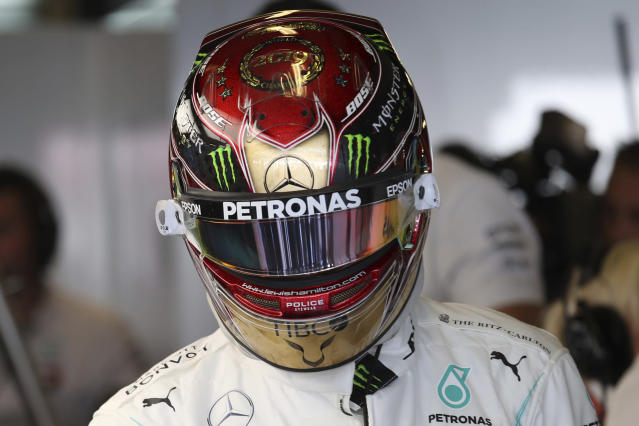 Mercedes driver Lewis Hamilton of Britain stands next to his car during the third free practice at the Yas Marina racetrack in Abu Dhabi, United Arab Emirates, Saturday, Nov. 30, 2019. The Emirates Formula One Grand Prix will take place on Sunday. (AP Photo/Kamran Jebreili)