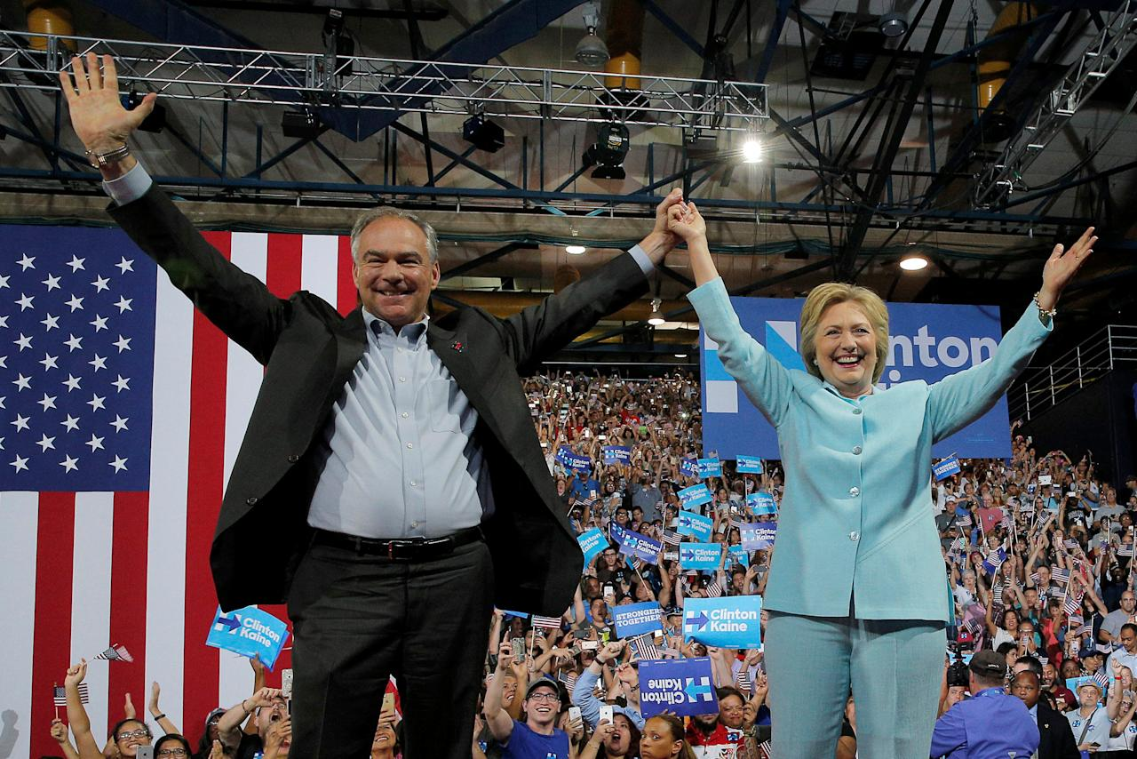 U.S. Democratic presidential candidate Hillary Clinton and Democratic vice presidential candidate Senator Tim Kaine take the stage at a campaign rally in Miami, Florida, U.S. July 23, 2016.  REUTERS/Brian Snyder     TPX IMAGES OF THE DAY