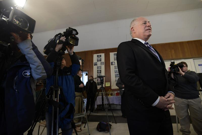 Illinois Gov. Pat Quinn waits in line before voting at Galewood Community Church in Chicago, Tuesday, March 18, 2014. (AP Photo/Paul Beaty)