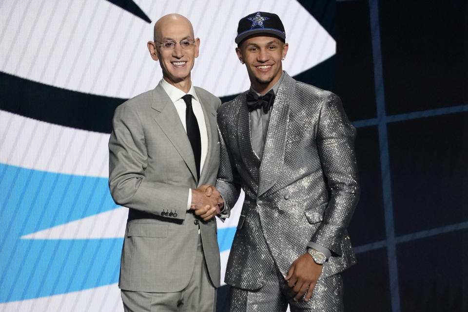 Jalen Suggs, right, poses for a photo with NBA Commissioner Adam Silver after being selected fifth overall by the Orlando Magic during the first round of the NBA basketball draft, Thursday, July 29, 2021, in New York. - Credit: AP