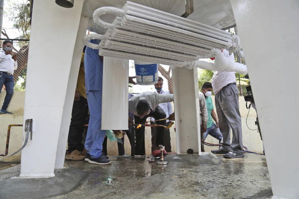 Hospital staff fix a leakage in their oxygen plant in Nashik, in the Indian state of Maharashtra, Wednesday, April 21, 2021. A local administrator in western India says 22 patients have died in a hospital when their oxygen supply was interrupted by a leakage in a supply tank. The official says the oxygen supply has since been resumed to other patients. (AP Photo)