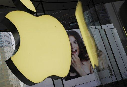 Apple's logo sign hangs in an Apple shop in Shanghai in April