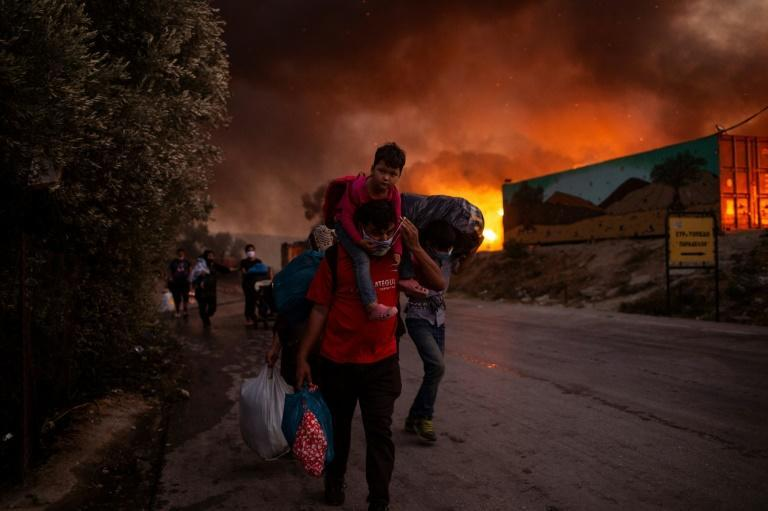 The two-day blaze forced families with young children to flee into the surrounding towns and villages (AFP/ANGELOS TZORTZINIS)