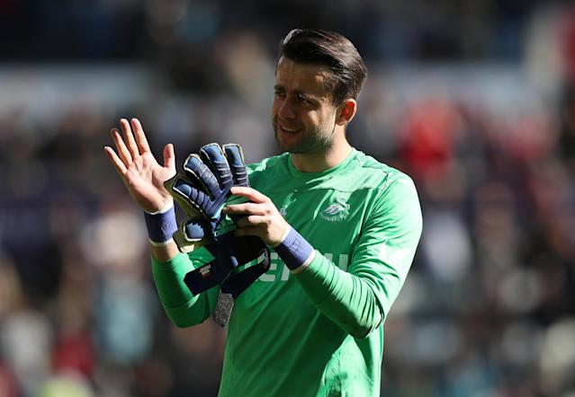 "Soccer Football - Premier League - Swansea City vs Stoke City - Liberty Stadium, Swansea, Britain - May 13, 2018 Swansea City's Lukasz Fabianski applauds their fans after the match as they are relegated from the Premier League Action Images via Reuters/Peter Cziborra EDITORIAL USE ONLY. No use with unauthorized audio, video, data, fixture lists, club/league logos or ""live"" services. Online in-match use limited to 75 images, no video emulation. No use in betting, games or single club/league/player publications. Please contact your account representative for further details."
