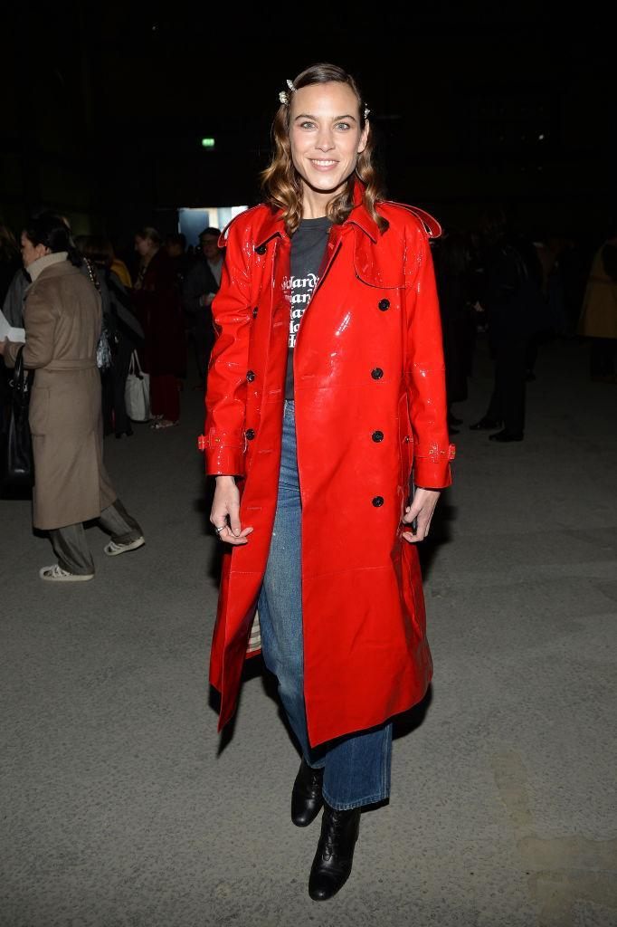 <p>Alexa Chung joined the star-studded FROW at Burberry in a red patent trench and flared jeans. <em>[Photo: Getty]</em> </p>