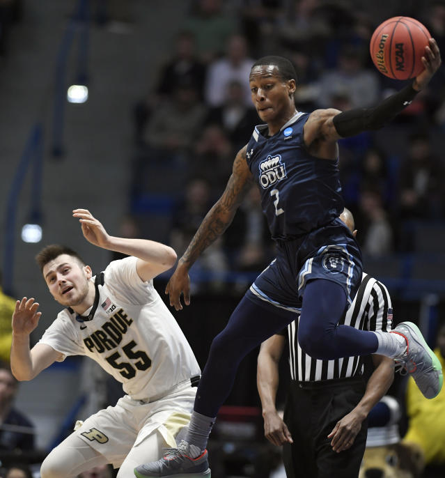 Old Dominion's Justice Kithcart, right, keeps the ball in play as Purdue's Sasha Stefanovic, left, defends during the first half of a first round men's college basketball game in the NCAA tournament, Thursday, March 21, 2019, in Hartford, Conn. (AP Photo/Jessica Hill)