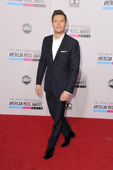 Ryan Seacrest arrives on the 2012 American Music Awards red carpet.