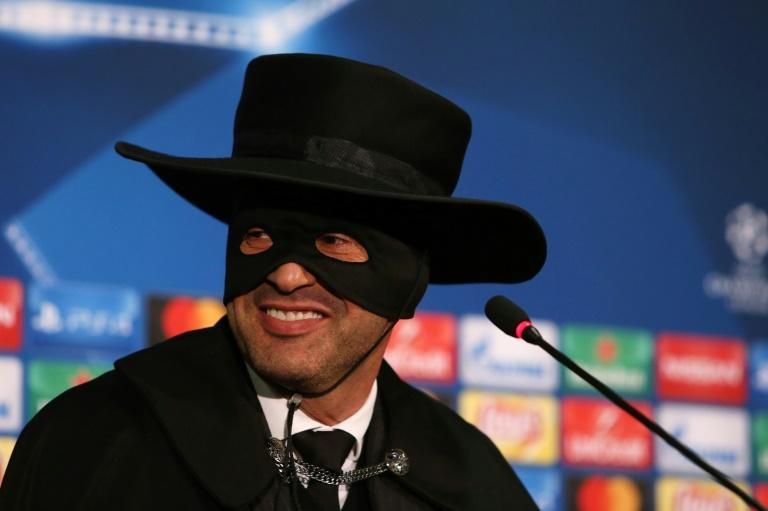 Shakhtar Donetsk's Paulo Fonseca, wearing a Zorro mask and hat, delivers a press conference after Shakhtar Donetsk won their match against Manchester City on December 6, 2017