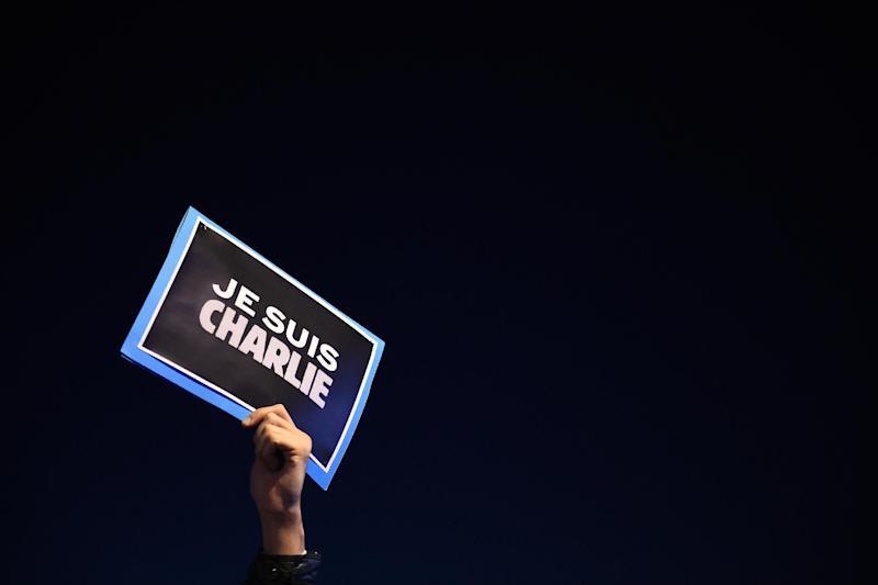 """A man holds a placard reading """"I am Charlie"""" in Marseille, France, on January 7, 2015"""