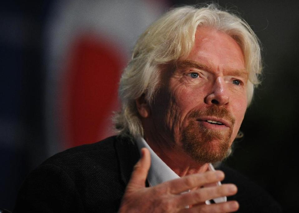 Sir Richard Branson has called for an end to subsidies for dirty fuels and oil drilling in the Arctic, and for a cap on coal and a carbon tax (AFP Photo/Mandel Ngan)