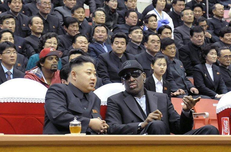"""Kim Jong-Un (front left) and Dennis Rodman at a basketball game in Pyongyang on February 28, 2013. Flamboyant former NBA star Rodman has lauded North Korea's new leader as an """"awesome kid"""" following an unprecedented meeting with Kim Jong-Un at a basketball game in Pyongyang"""