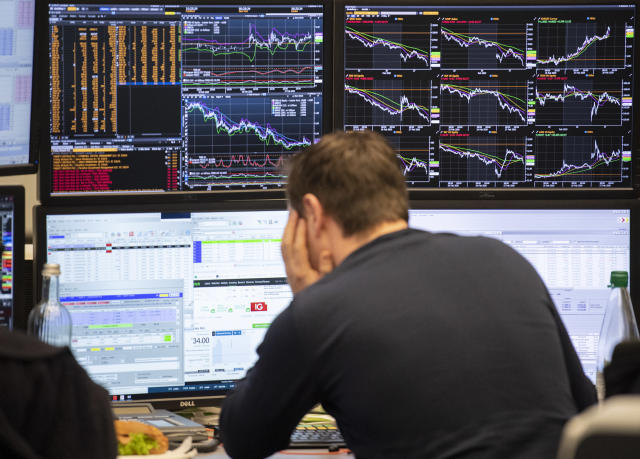 An exchange trader at the Frankfurt Stock Exchange looks at his monitors. (Boris Roessler/picture alliance via Getty Images)