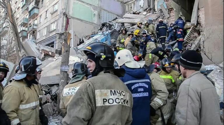 Rescue workers carry out a survivor of the gas blast at a residential building in Russia's Urals city of Magnitogorsk