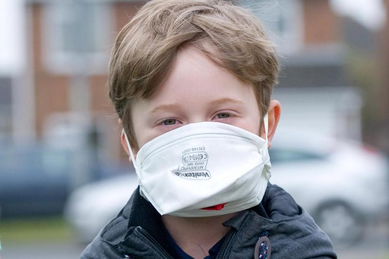 Mask: High levels of pollution are putting children at risk (Rex)